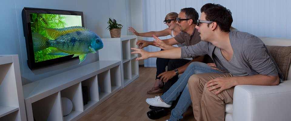 3D Tv - A Guide To 3D Movies And Television: People Watching 3D Tv In A Room