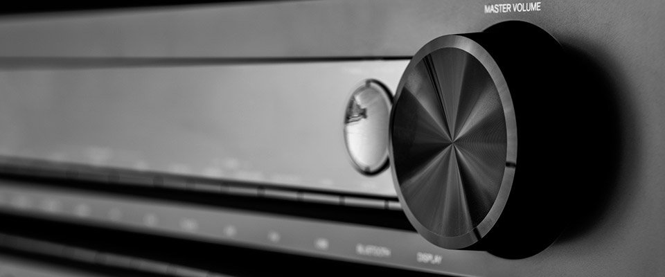 Featured image for - Arcam AV Receivers: the FMJ Series Compared. Master volume control on an AV receiver.