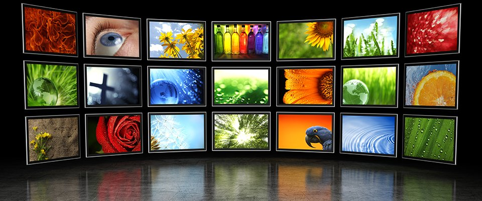 Best LED & OLED Flat Screen TVs: Reviews & Buying Guide - wall of LED TVs