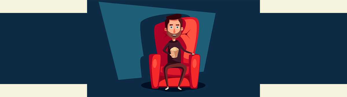 Man In Home Theater Watching Movie With Popcorn
