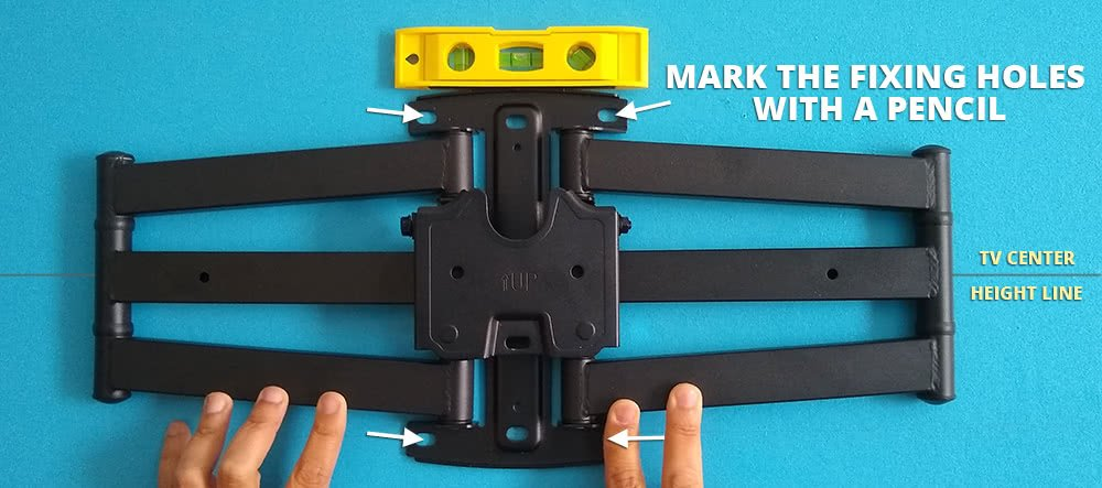 Mark The Tv Wall Mount Fixing Holes With A Pencil