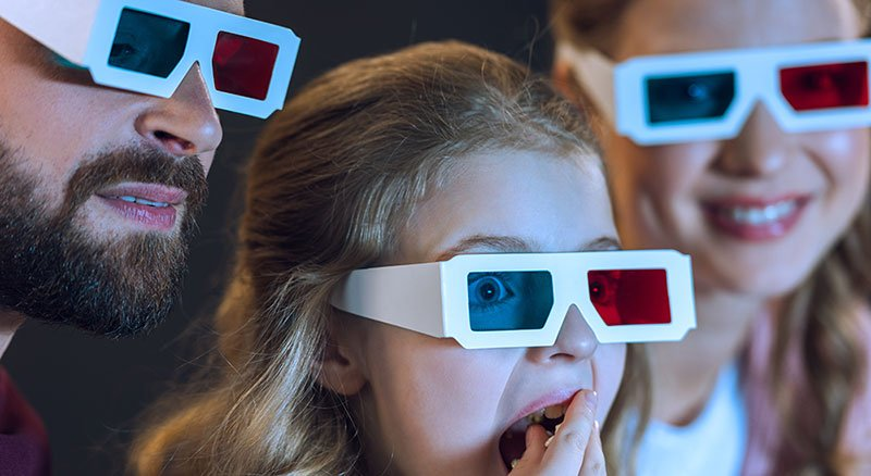 People Watching A 3D Movie With Glasses